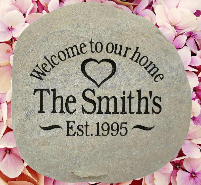 "Beautiful custom engraved rocks with this example displaying the words ""Welcome to our home - The Smith's - Est. 1995""."